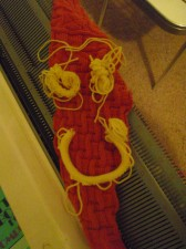 """Smile!  The first yellow """"worms"""" I made on top of the vastly improved knitting of last night, makes me SMILE!"""
